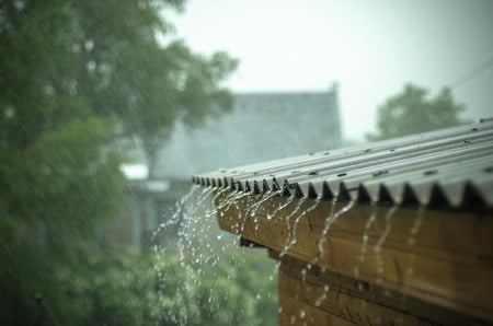 65459917 - rain flows down from a roof down