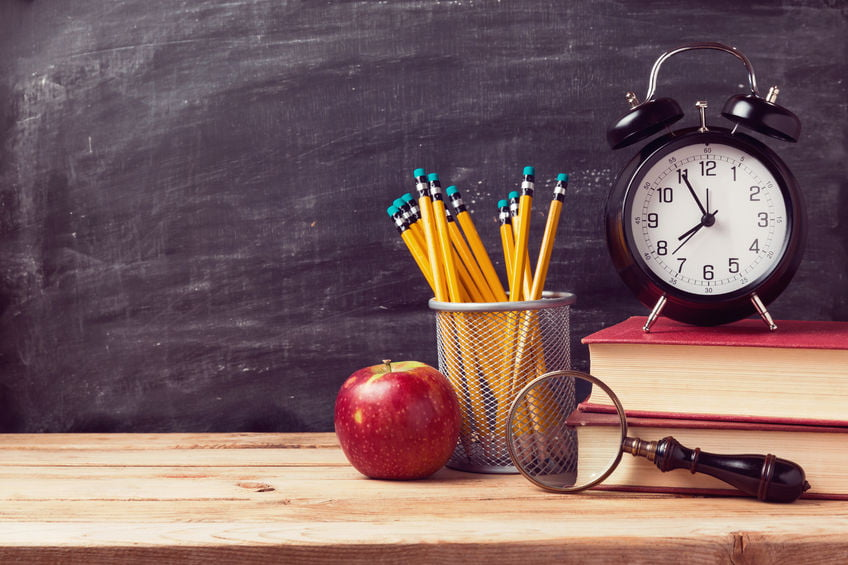 41985313 - back to school background with books and alarm clock over chalkboard