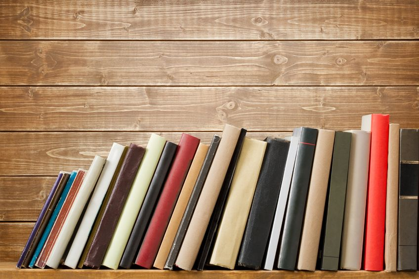 20343649 - old books on a wooden shelf. no labels, blank spine.